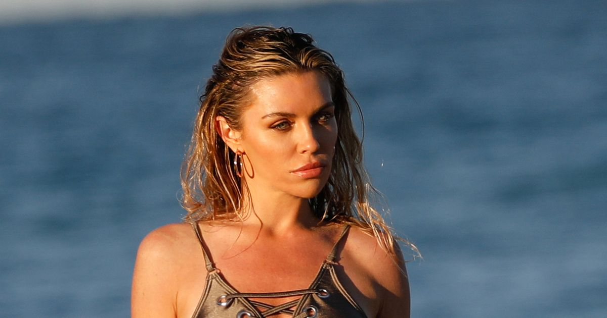 Abbey Clancy looks sensational as she slips into high-cut swimsuit at the beach