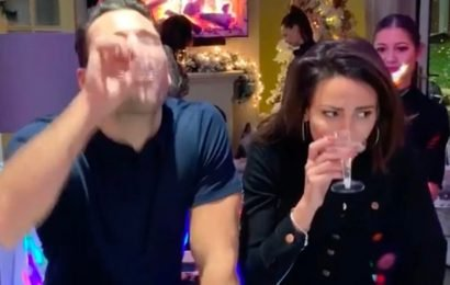 Mark Wright and Michelle Keegan neck booze as they face off in drinking game