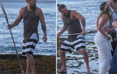 Jason Momoa Plays With Trident on a Beach in Hawaii, Photobombs Newlyweds