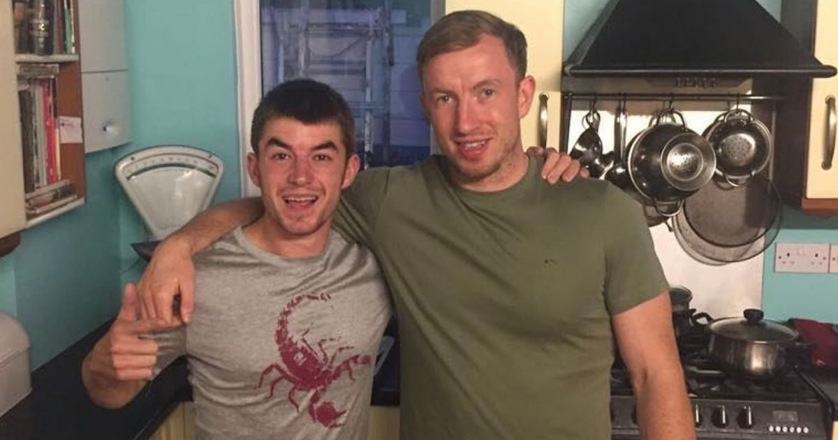 X Factor's Anthony Russell poses with convicted gun dealer in controversial pics