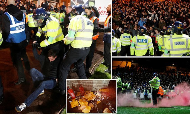 At least 11 are arrested as Stoke City fans pelt police with bottles