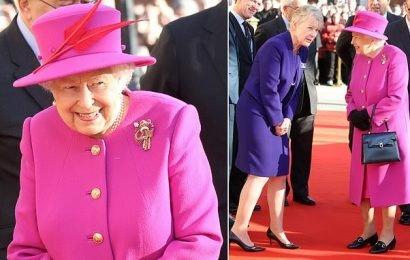 The Queen puts on a vibrant display in fuchsia coat and hat in London