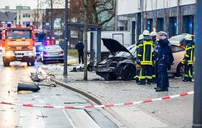 Woman dead and eight injured when car crashes into German bus stop