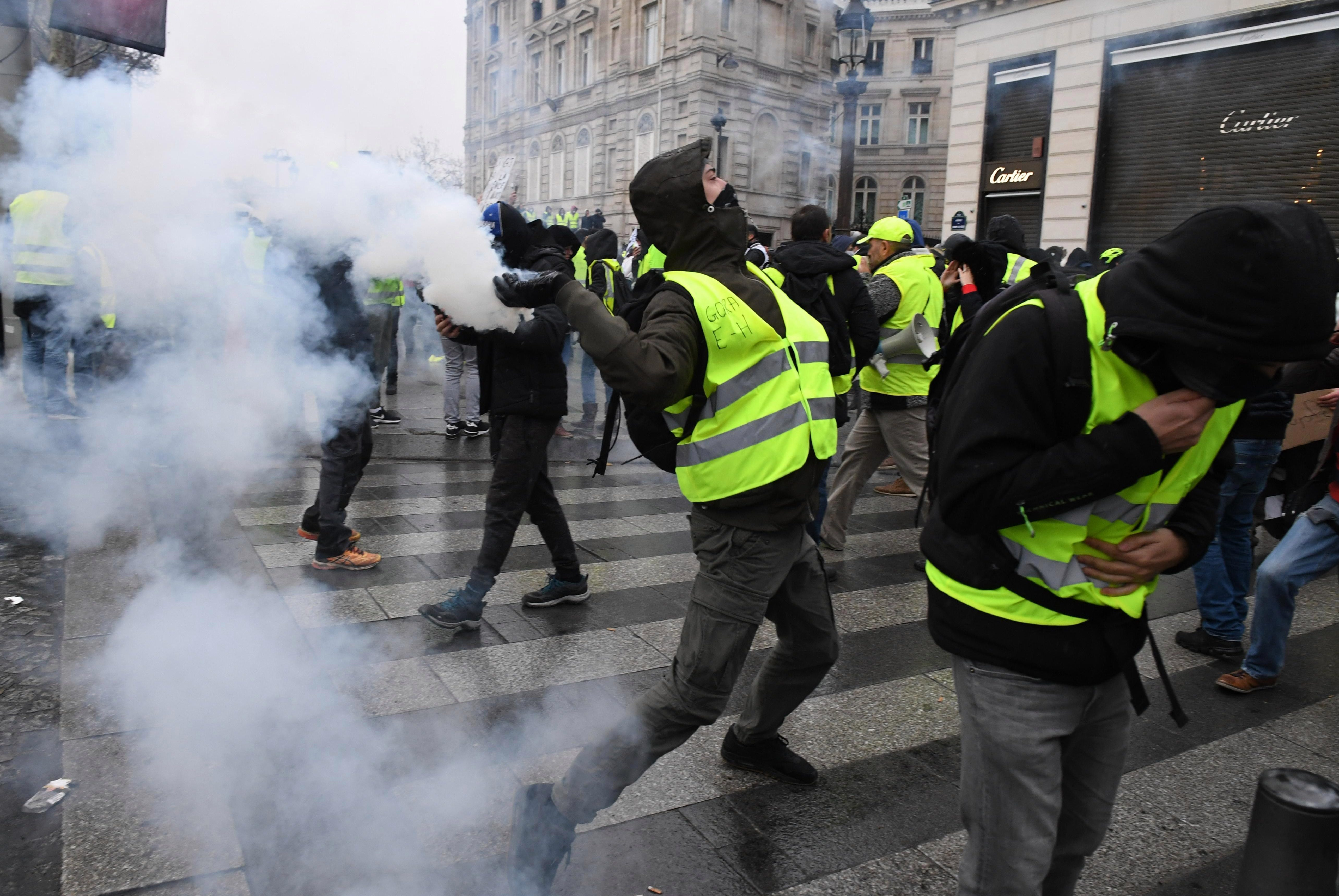 Paris in lockdown with tear gas fired as 5,000 protesters descend for 'Day of