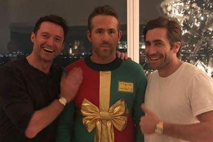 Ryan Reynolds gets tricked into wearing tacky Christmas jumper by Hugh Jackman and Jake Gyllenhaal