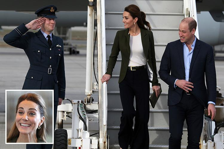 Kate Middleton gets cheeky smile from saluting airmen as she and Wills arrive at RAF base to honour pilots smashing ISIS over Xmas