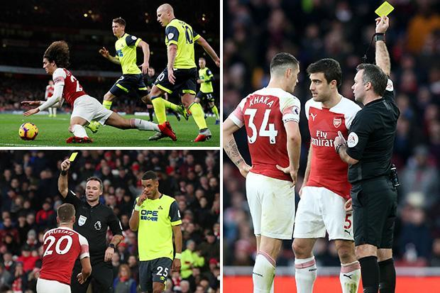 Arsenal have three players booked for diving against Huddersfield as they face defensive crisis