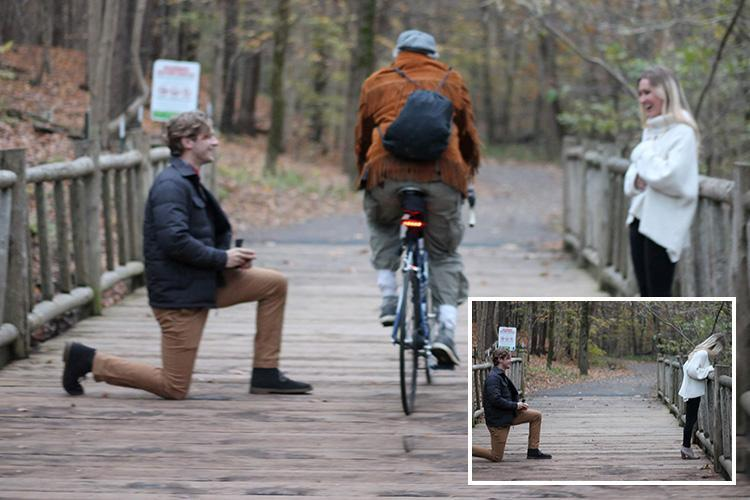 Cyclist ruins marriage proposal by riding past as man pops the question — and a photographer captures the moment