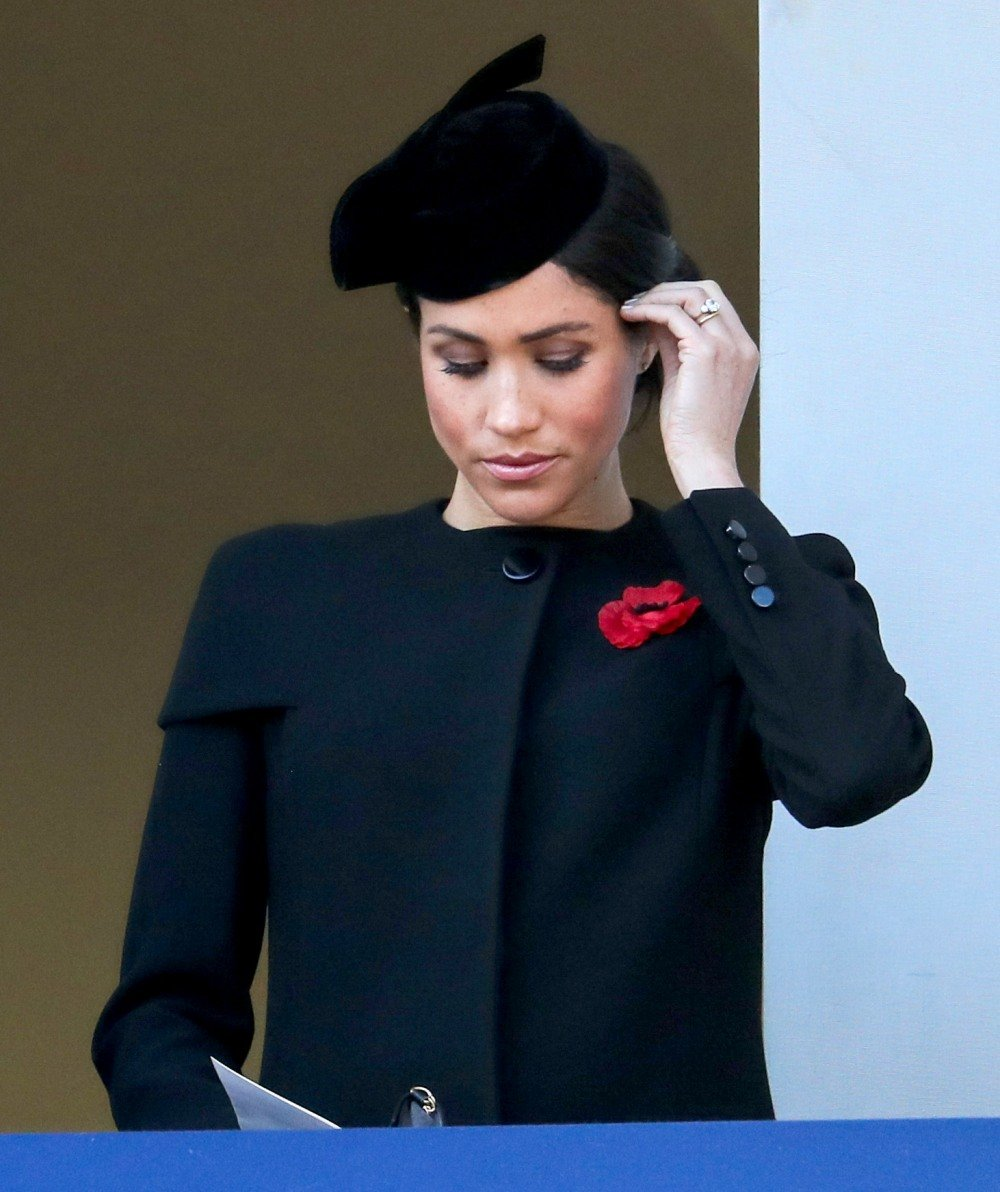 Duchess Meghan isn't reading the smear-campaign articles, she's 'a believer in karma'