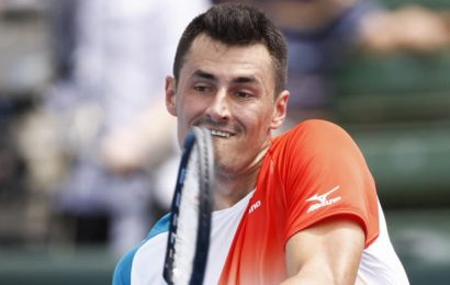 Tomic fights back to win low-key Kooyong Classic opener