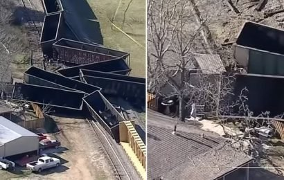 Freight train derails and crashes into a backyard in Texas