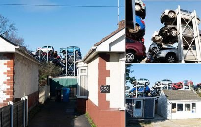 50ft mountain of scrapped cars tower over back gardens
