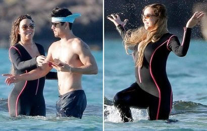 Mariah Carey makes a splash in a busty wetsuit as she frolics with boyfriend Bryan Tanaka in St Barts