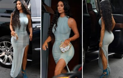 Kim Kardashian wows in skintight dress as she leaves Miami hotel with Kanye West
