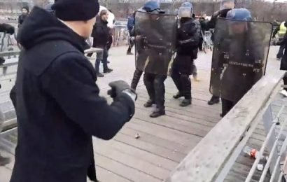 Former pro boxer takes on French riot police, turns himself in