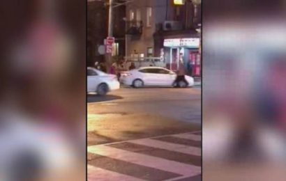 Road rage incident in downtown Toronto shows man jumping on hood of moving car