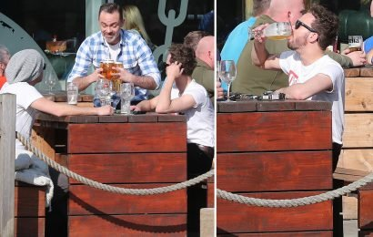 Coronation Street's Jack P Shepherd downs beer in the sun with co-star Daniel Brocklebank on afternoon off from soap filming