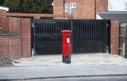 Family stuck with 100-year-old postbox in the MIDDLE of their driveway after installing gates insist 'we've improved the area'