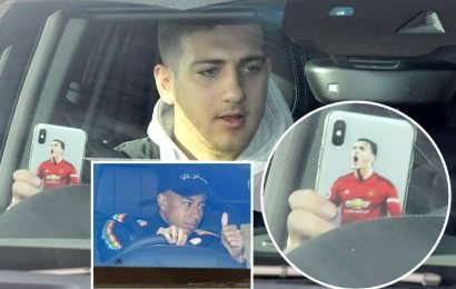 Dalot on brand for Man Utd as defender shows off phone cover of HIMSELF on way into training