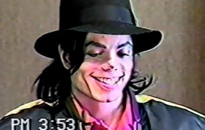 Michael Jackson giggles and smiles as he's quizzed by cops over child sex abuse allegations in unearthed video