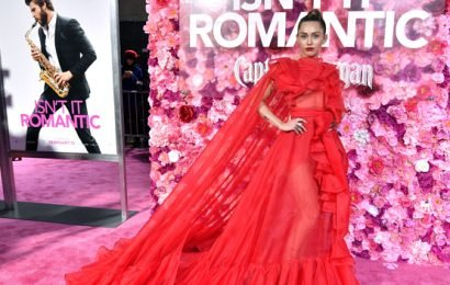 Miley Cyrus Stuns In Sheer Red Gown At 'Isn't It Romantic' Premiere As Hubby Liam Recovers At Home