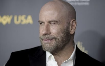 John Travolta says his bald look is his biggest news since Oscar flub, credits Pitbull