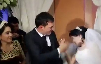 Groom slaps bride in front of stunned wedding guests for taking away his cake