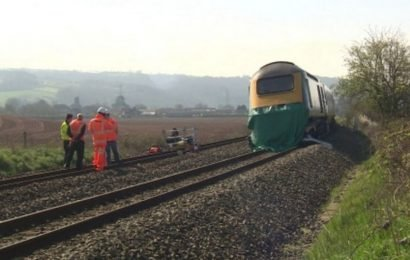 Man, 23, dies after car hit by train on level crossing in Devon