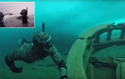 Freediver plunges intofrozen lake to explore remains of shipwreck