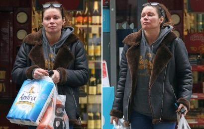 Make-up free Alison King buys loo roll in a break from filming Coronation Street's dramatic arrest scenes as Carla Connor