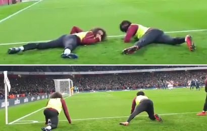 Watch moment Arsenal subs Guendouzi and Iwobi duck for fans so they can see Aubameyang's penalty against Man Utd