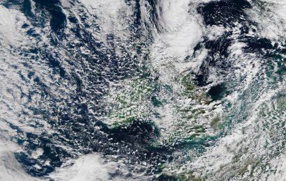 What do yellow weather warnings mean and when does the Met Office issue them in the UK?