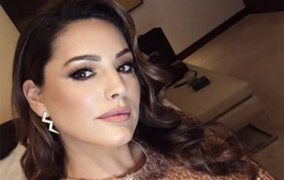 Kelly Brook teases fans in saucy slit dress: 'Well fit'