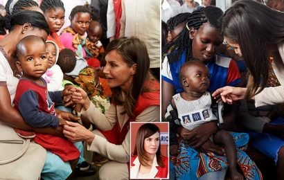 Spain's Queen Letizia beams as she greets toddlers in Mozambique