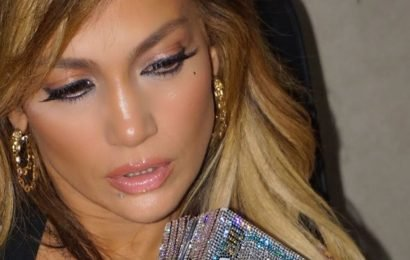 Jennifer Lopez Casually Held a Swarovski-Encrusted Clutch That Looks Like a Stack of Money