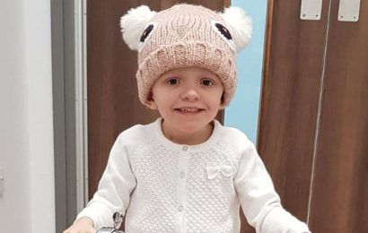 Brave three-year-old girl with cancer beams after last session of proton therapy