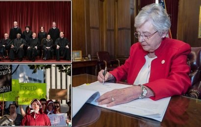 Alabama governor signs bill authorizing near total ban on abortions