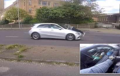 Terrifying moment 'road rage victim' desperately clings to bonnet