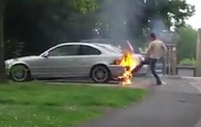 BMW driver tries to BLOW OUT fire engulfing his car before it explodes