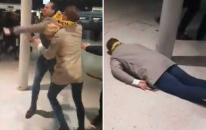 Shocking moment sports fan is knocked unconscious with single punch in London Waterloo brawl