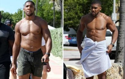 Anthony Joshua strips down on Miami beach exposing his ripped body ahead of fight with 'fat slob' Andy Ruiz