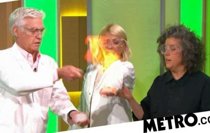Holly Willoughby screams as she sets fire to hand on This Morning