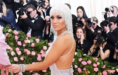 Jennifer Lopez Sizzles In Silver Sequin Mini Dress With Matching Headpiece At The 2019 Met Gala