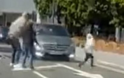 Heart-stopping moment a young child narrowly avoids being hit by a car