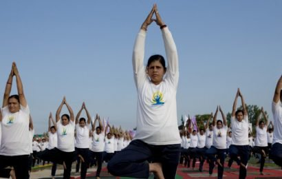 Thousands of people get into a twist for Yoga Day