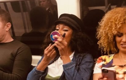 Spice Girls' Mel B stuns tube passengers as she does her make-up on the way to the group's Wembley gig