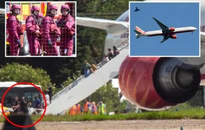 Armed cops 'quarantine' 400 passengers on Air India flight diverted to London Stansted Airport after RAF Typhoons scrambled over 'bomb threat'