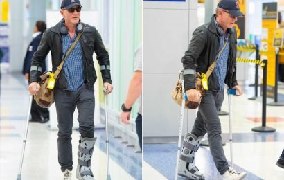 Daniel Craig makes his way through JFK Airport on crutches