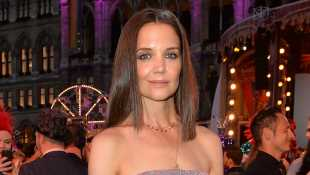 Katie Holmes Looks Ethereal In White Dress While Visiting The Lion King & Jungle Festival In Paris