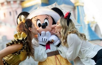 Models can't get enough of Mickey and Minnie at Disneyland Paris